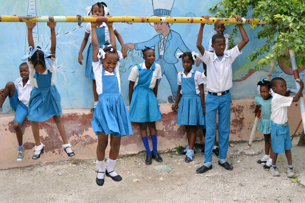 A group of young Haitian students playing at L'Ecole Dinaus Mixed