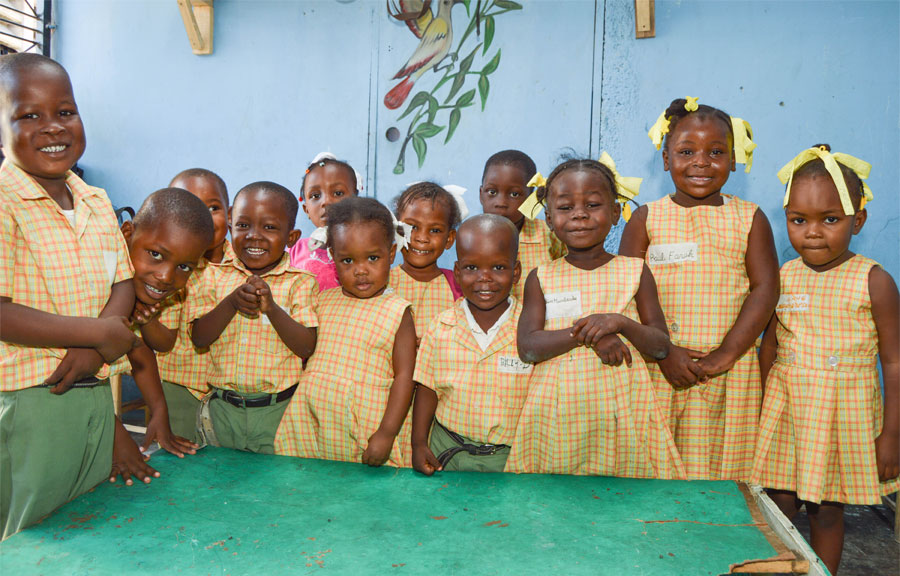 Haitian children at L'Ecole Dinaus Mixed smiling in their uniforms