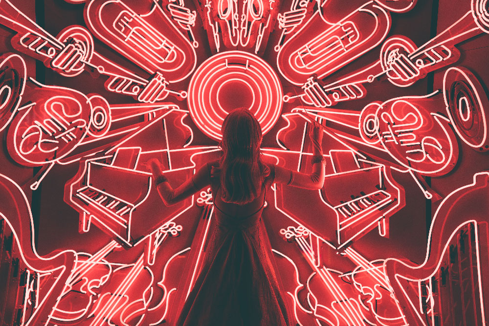 Silhouette of a woman in front of a background of red neon instruments
